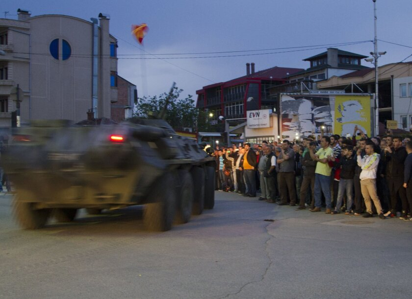 Macedonian special police leave the area where a battle took place with an armed group Sunday in the northern Macedonian town of Kumanovo.