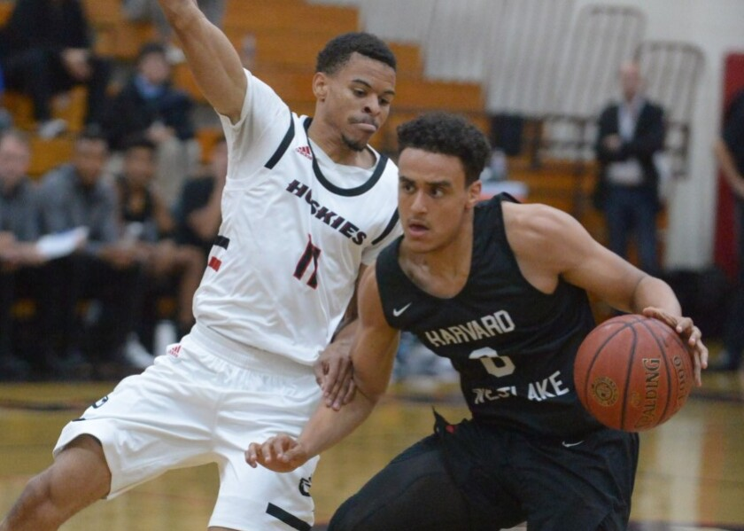 Harvard-Westlake's Holden McRae drives against Corona Centennial's Paris Dawson. Harvard-Westlake is 11-0 and is No. 3 in this week's basketball rankings.