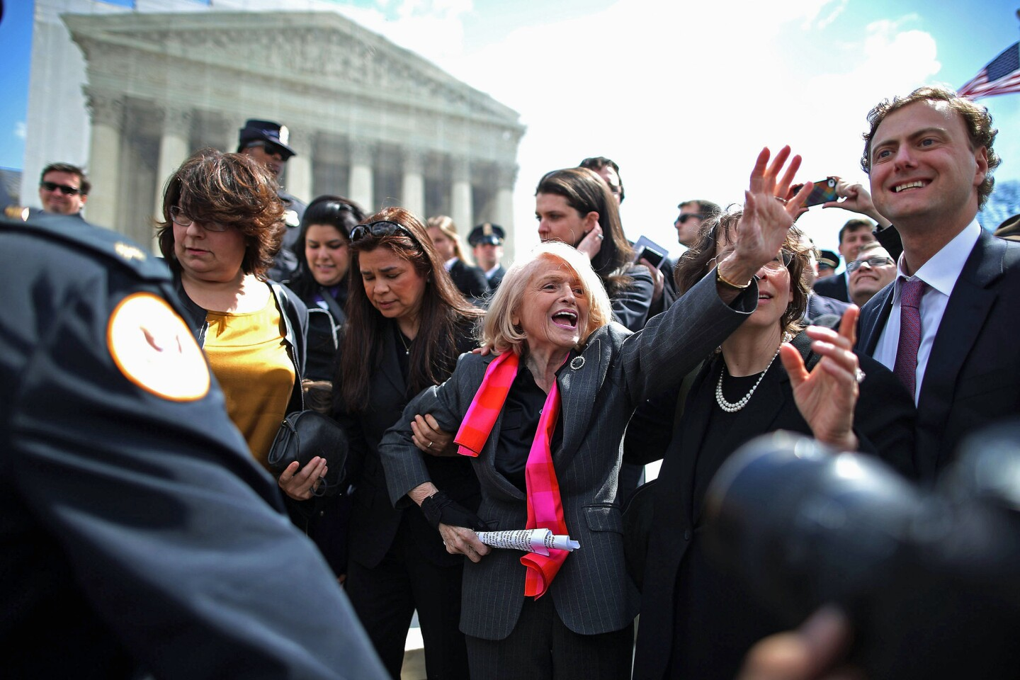 Edith Windsor, 83, is mobbed by journalists and supporters as she leaves the Supreme Court on Wednesday. Windsor brought the case challenging the constitutionality of the federal Defense of Marriage Act.