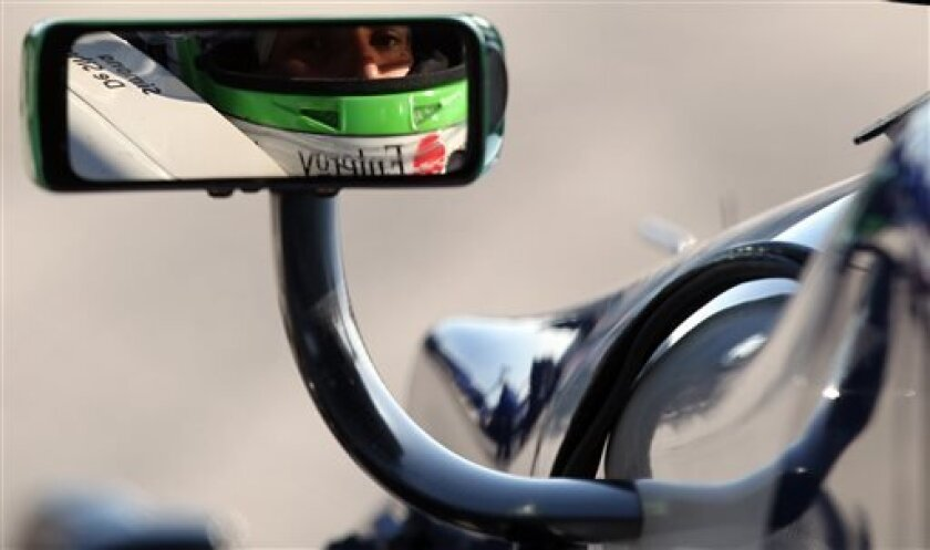 Simona de Silvestro, of Switzerland, sits in her car on pit road during practice for the IndyCar Grand Prix of Alabama on Saturday, April 6, 2013 in Birmingham, Ala. (AP Photo/Butch Dill)