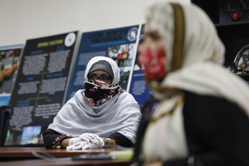 Ruqiya Abdi and Hindi Mohamed received help from the Somali Family Services to apply for a government program in 2020.