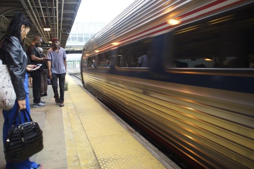 An Amtrak train heading to New York departs Trenton, N.J., on Monday.