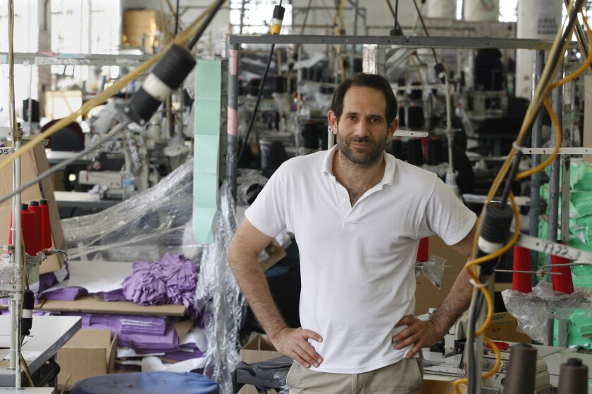 Dov Charney, founder of American Apparel, poses for photos at the company's factory in downtown Los Angeles on April 3, 2012.