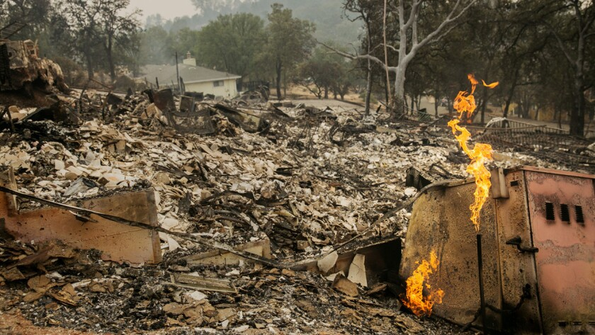 The Valley fire tore through a half dozen homes in the residential community of Hidden Valley Lakes, near Middletown, Calif.