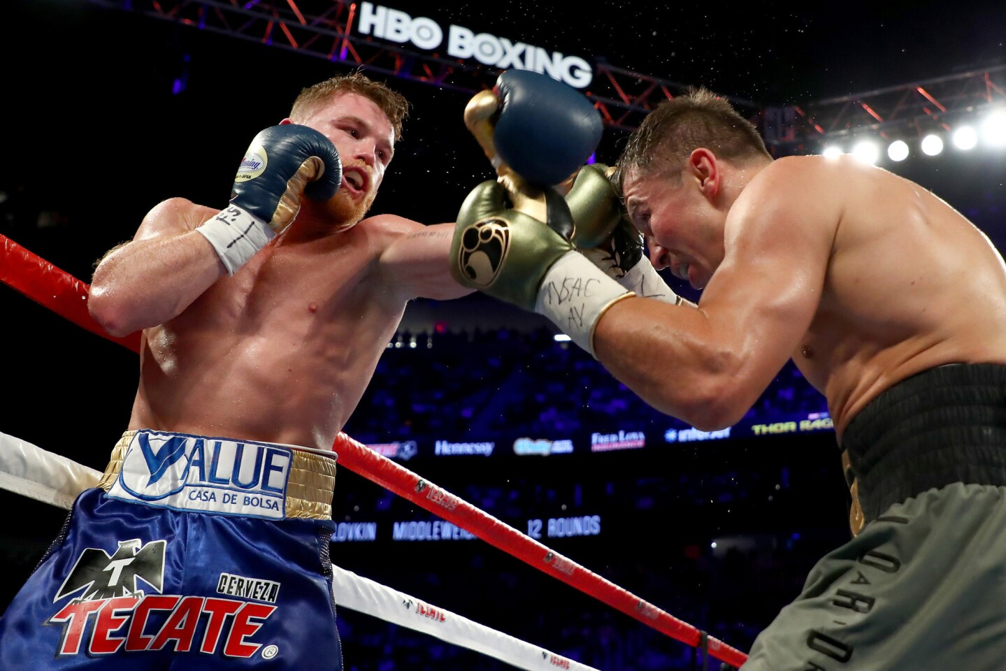 Gennady Golovkin, right, tries to evade a punch by Canelo Alvarez during their middleweight championionship bout.