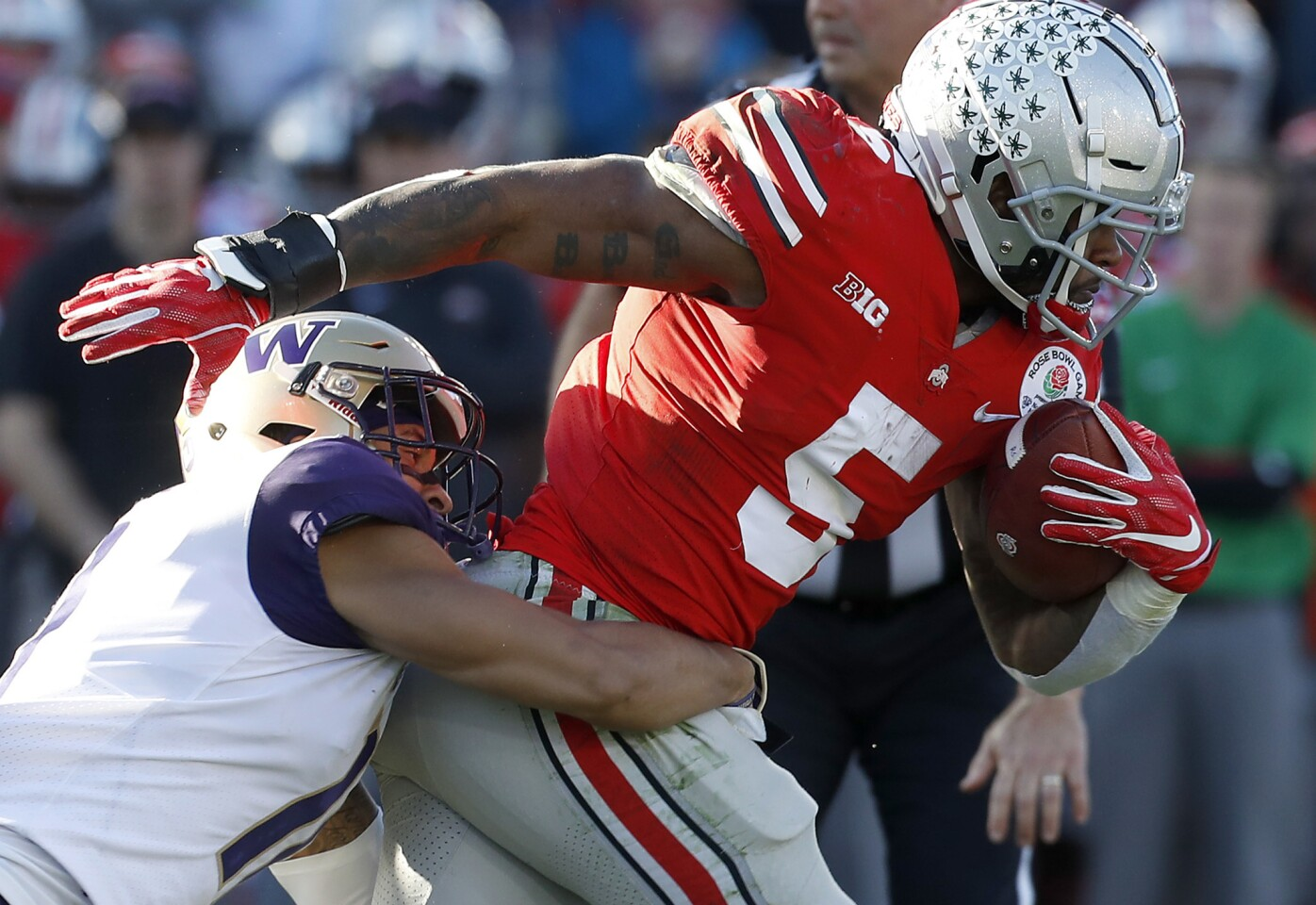 Ohio State running back Mike Weber Jr. drags Washington defensive back Brandon McKinney for a first down on Jan. 1 at the Rose Bowl.