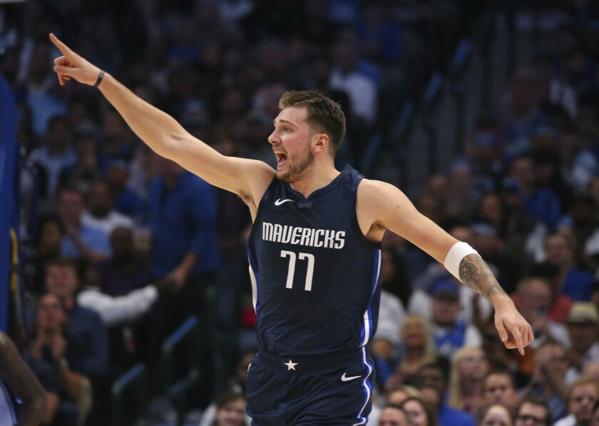 Dallas Mavericks guard Luka Doncic gestures after sinking a basket during the first half against the Orlando Magic in an NBA basketball game Wednesday, Nov. 6, 2019, in Dallas. (AP Photo/Richard W. Rodriguez)