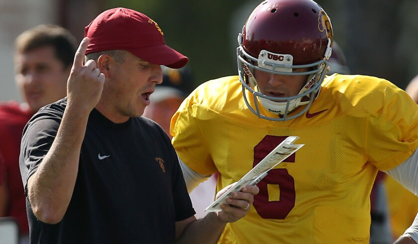 USC offensive coordinator Clay Helton led quarterback Cody Kessler and the Trojans to a victory in the Las Vegas Bowl during his first stint as interim coach.
