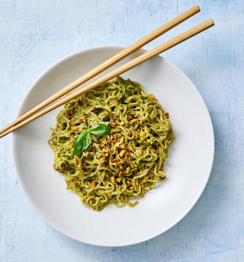 A nutty, savory pesto made with rich pistachios coats ramen noodles in this under five-ingredient noodle dish. Prop styling by Nidia Cueva.