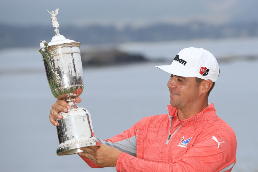 Gary Woodland of the United States poses with the trophy after winning the 2019 U.S. Open at Pebble Beach Golf Links on June 16, 2019 in Pebble Beach, California.