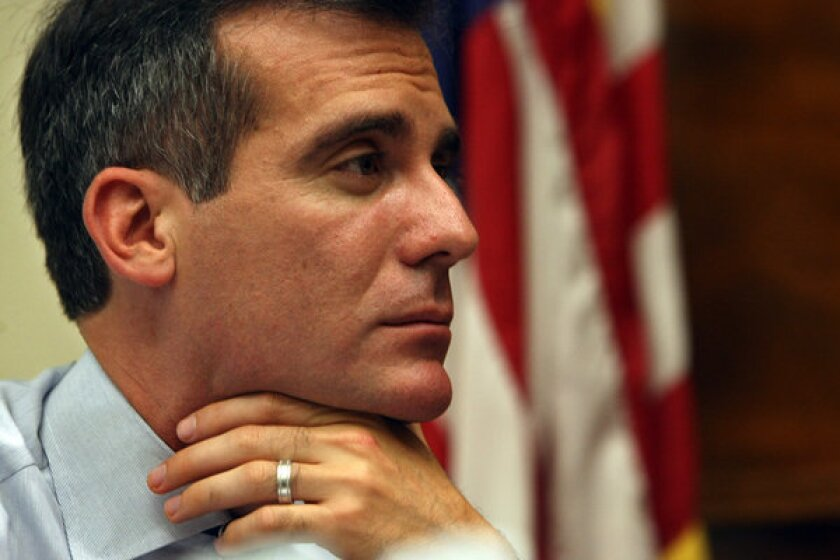 Los Angeles Mayor Eric Garcetti listens to constituents talk about issues of concern in the community on his first day in office at City Hall.