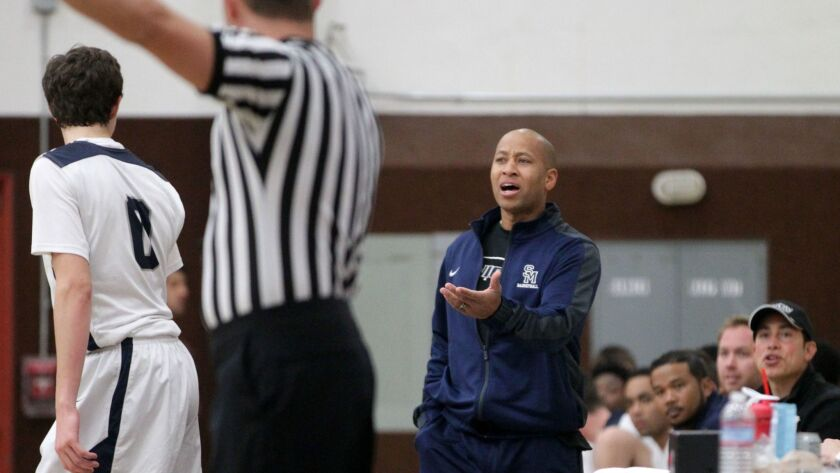 San Marcos coach Dante Carey argues his case with the referee.
