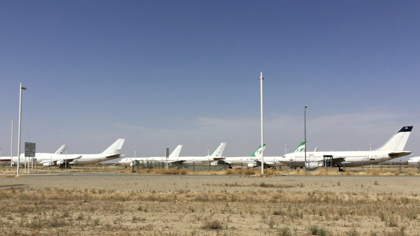 Airplanes are mothballed at the international airport in Tehran.