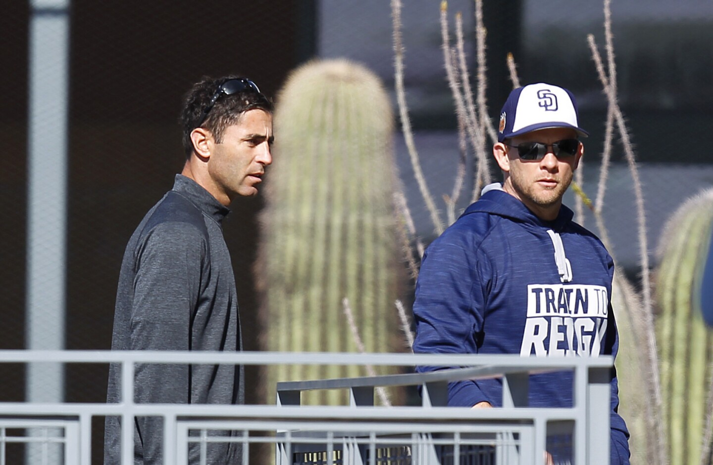 San Diego Padres General Manager A.J. Preller and manager Andy Green walk to the clubhouse after a spring training practice. (Photo by K.C. Alfred/The San Diego Union-Tribune)