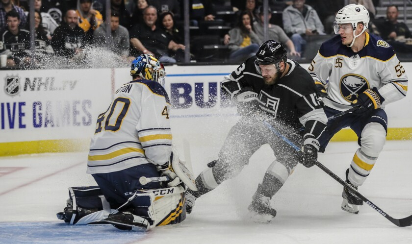 Buffalo Sabres goaltender Carter Hutton stops a shot by Kings left wing Kyle Clifford.