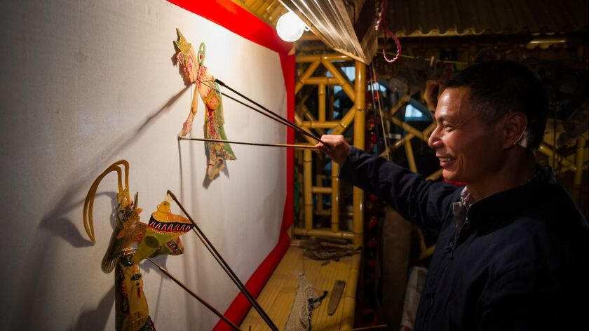 A chinese shadow puppetry player was playing shadow theatre