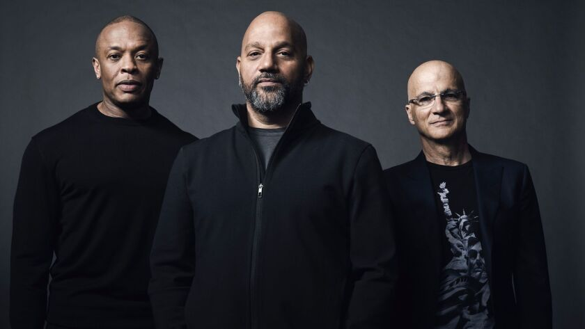 """From left: Dr. Dre, director Allen Hughes, and Jimmy Iovine are behind the HBO documentary """"The Defiant Ones,"""" premiering July 9."""