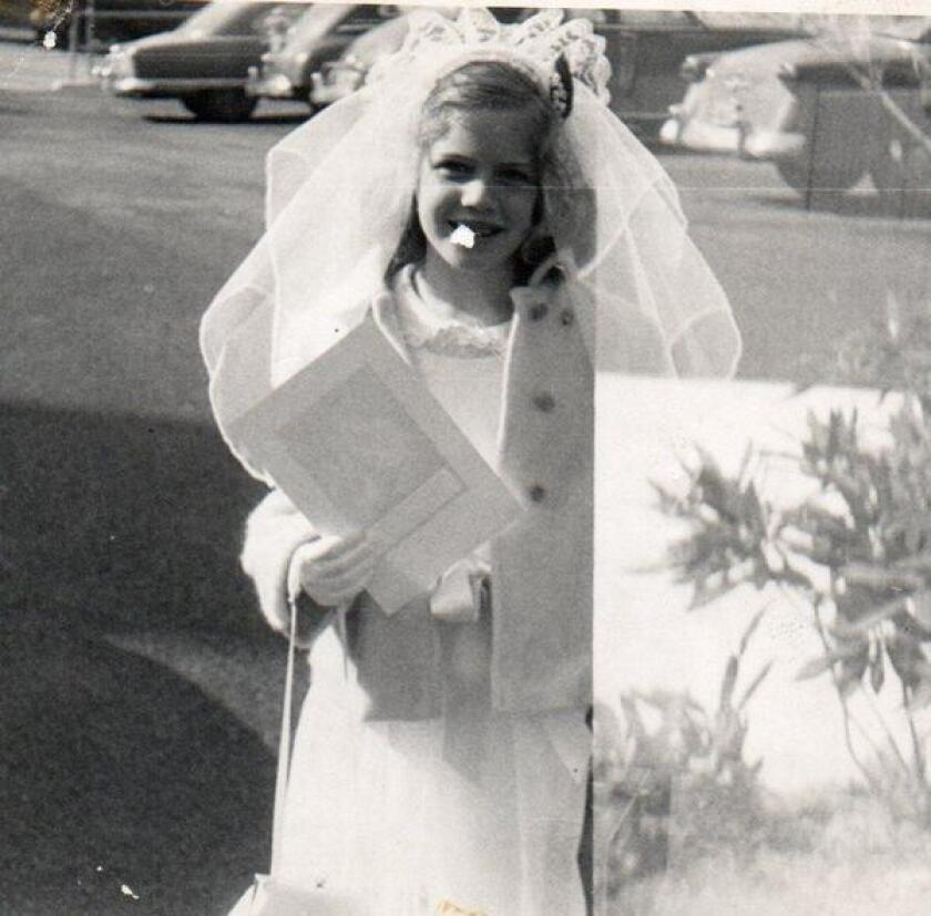 Inga wearing the much-disputed First Holy Communion veil.