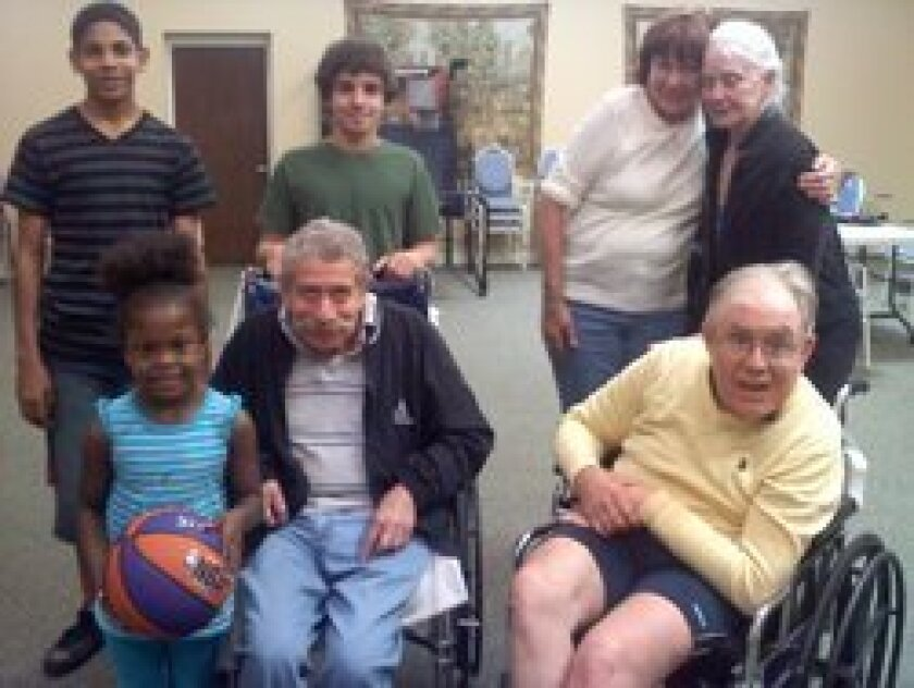 Kids Korps members enjoy an afternoon with residents of the Silverado Senior Living Community.