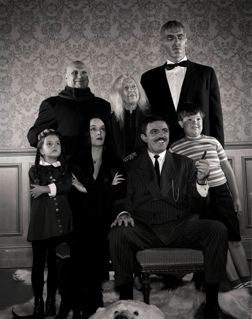 "Lisa Loring, Carolyn Jones, John Astin, Ken Weatherwax, Jackie Coogan, Blossom Rock and Ted Cassidy in ""The Addams Family"" TV show."