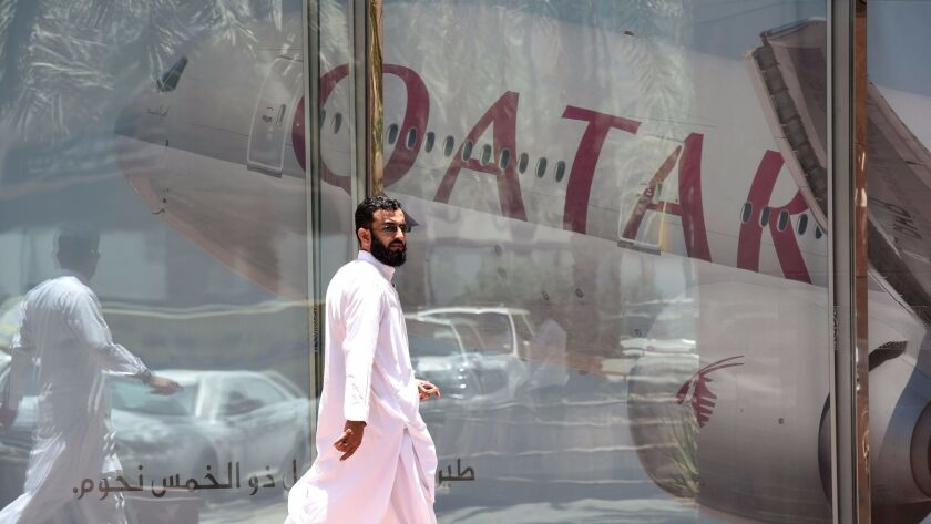 A man walks past the Qatar Airways branch on June 5, 2017, in the Saudi capital, Riyadh, after it suspended all flights to Saudi Arabia amid a severing of relations between major Persian Gulf states.