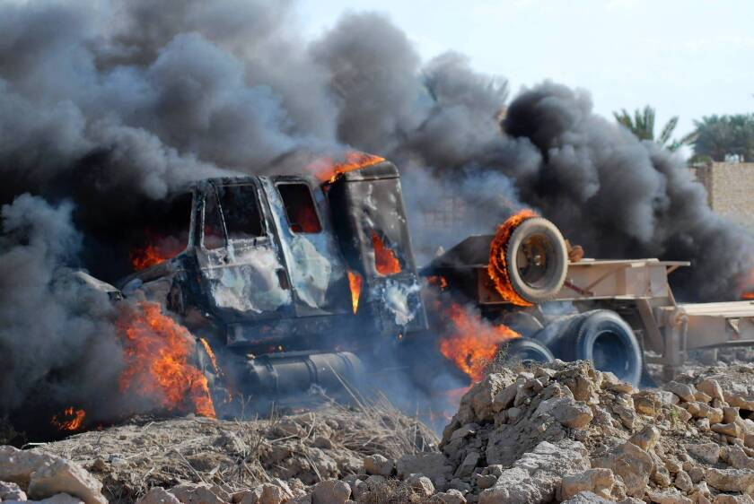A military vehicle burns during the unrest in Ramadi, Iraq, which erupted after a raid on a protest camp in Hawija.