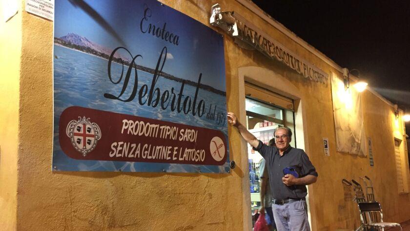 Antonio Debertolo outside his shop in the town of San Teodoro on the island of Sardinia.