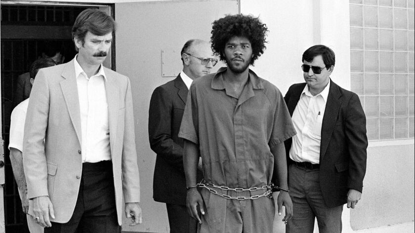Kevin Cooper, center, was convicted in 1985 of killing four people and sentenced to death. Years after the trial, experts and critics have raised doubts about whether authorities sent the right person to prison.