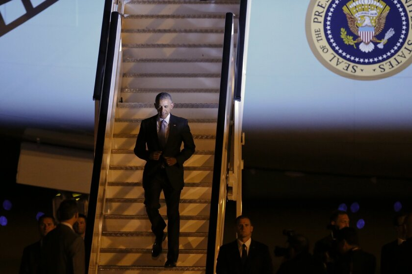 U.S. President Barack Obama disembarks the plane during his arrival at the Torrejon military air base in Madrid, Spain Saturday, July 9, 2016. On what is expected to be his last presidential visit to Europe, Obama is visiting Madrid for his first presidential visit to Spain. (AP Photo/Paul White)