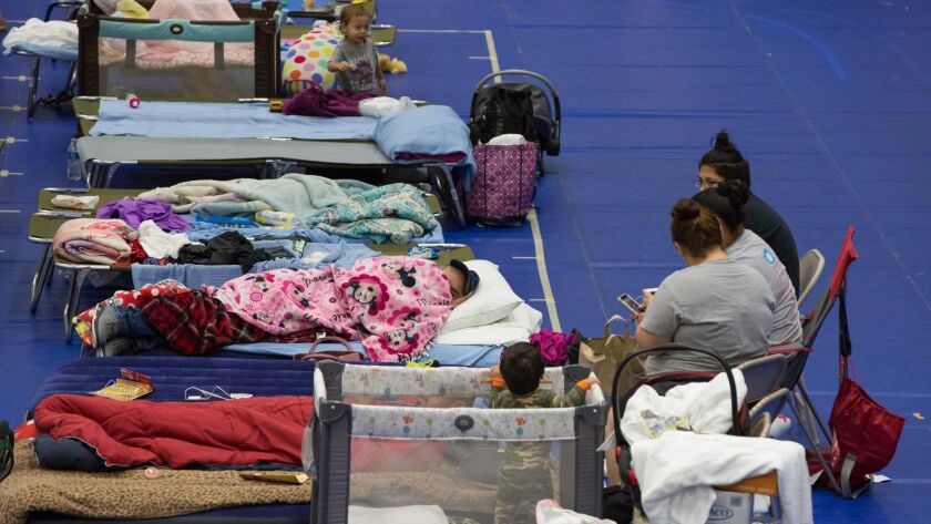 Evacuees take shelter at the Delco Center in Austin, Texas, on Sunday.