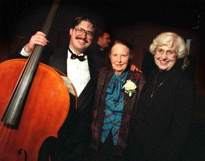 Violin maker Carleen Hutchins, center, is flanked by Joe McNalley and his mother, Sharon, after the inaugural performance by the Hutchins Consort.