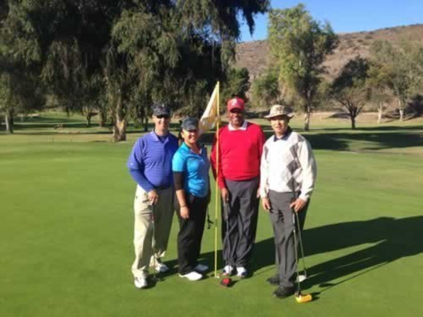 Navy veterans Chris Proctor, Desiree Del Rosario and Chauncey Mitchell with Marine George Barreto play golf at Camp Pendleton on Veterans Day 2012 to raise money and awareness for the Wounded Warrior Project. (Courtesy Photo)