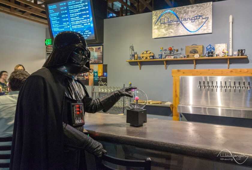 "Wavelength  Brewing Co. patron attends a ""Star Wars"" science talk hosted in their tasting room in Vista, Calif."