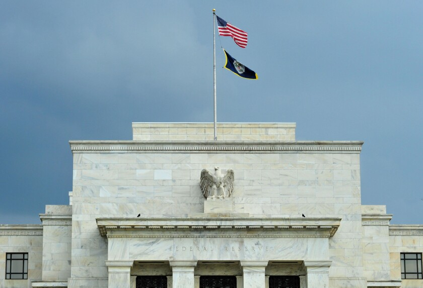 The Federal Reserve building in Washington, D.C. The Fed said it earned a record $98.7 billion in profit in 2014.