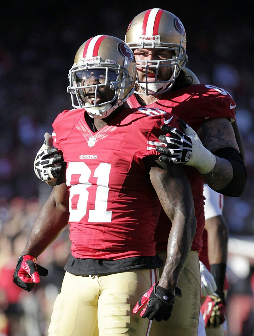 San Francisco 49ers wide receiver Anquan Boldin (81) celebrates with guard Adam Snyder after a reception during the second quarter of an NFL football game against the St. Louis Rams in San Francisco, Sunday, Dec. 1, 2013. The 49ers won 23-13. (AP Photo/Tony Avelar)