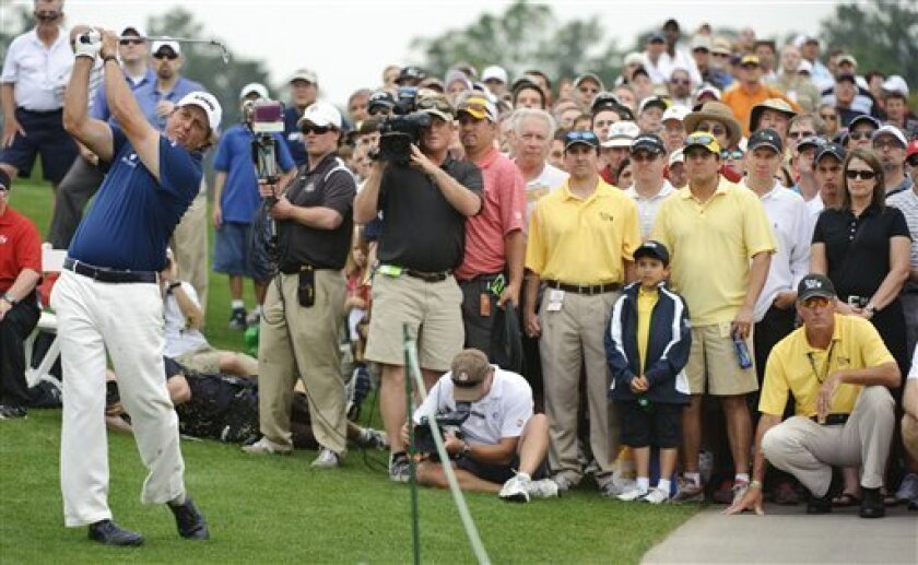 Phil Mickelson hits his second shot on the eighth hole during the final round of the Houston Open golf tournament, Sunday, April 3, 2011, in Humble, Texas. (AP Photo/Dave Einsel)