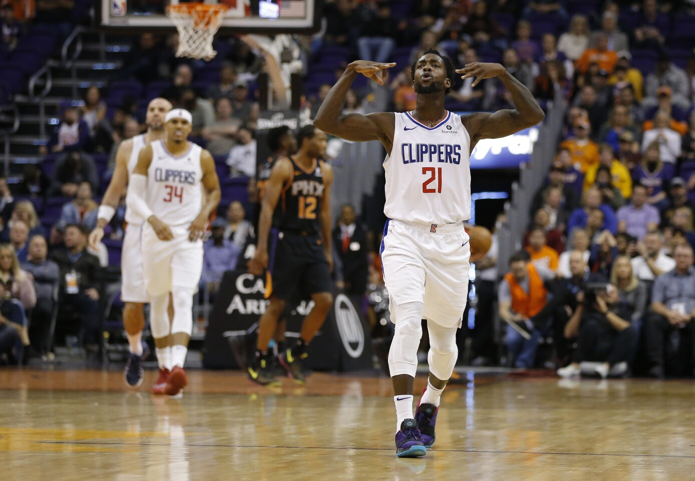 Los Angeles Clippers guard Patrick Beverley (21) in the first half during an NBA basketball game against the Phoenix Suns, Friday, Jan. 4, 2019, in Phoenix. (AP Photo/Rick Scuteri)