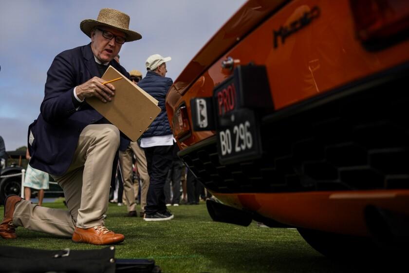 Chief Class Judge Winston Goodfellow surveys a 1968 Lamborghini Miura P400 Bertone Coupé