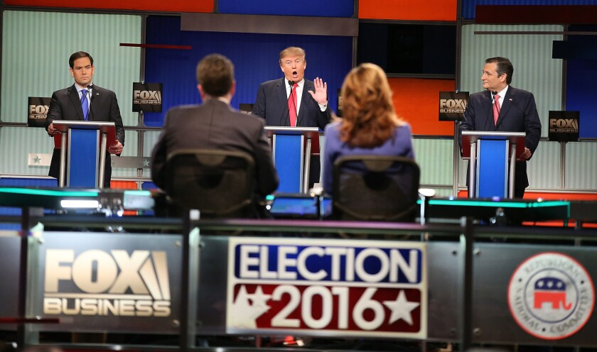 Marco Rubio, left, Donald Trump and Ted Cruz take part in the Republican debate in North Charleston, S.C.