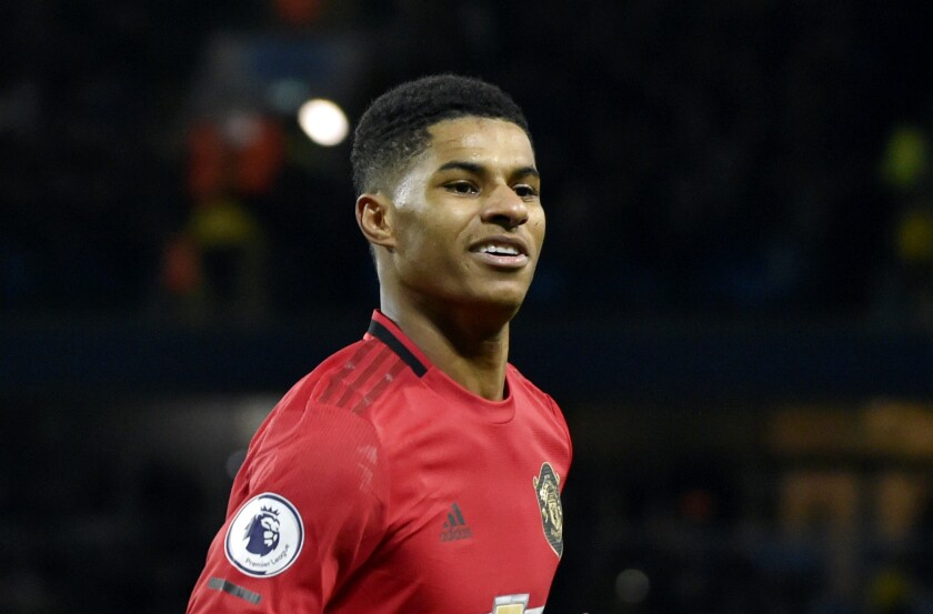 FILE - In this Saturday, Dec. 7, 2019 file photo, Manchester United's Marcus Rashford celebrates during an English Premier League soccer match against Manchester City at Etihad stadium in Manchester, England. British Prime Minister Boris Johnson faced growing pressure Tuesday, June 16, 2020 to make a policy U-turn as opponents and allies alike rallied behind a young soccer star's campaign to help families struggling with food poverty. Manchester United and England player Marcus Rashford is urging the government to provide free meals for needy students over the summer holidays.(AP Photo/Rui Vieira, file)