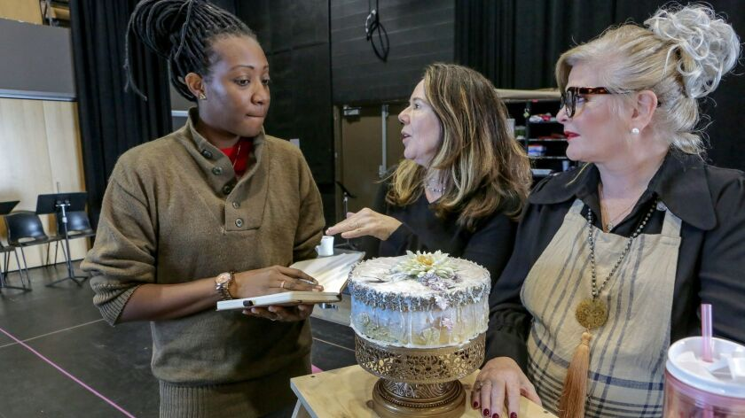 Director Casey Stangl, center, talks with actresses Miriam A. Hyman, left, who plays the part of Mac