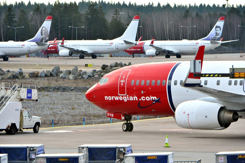 Aircraft for Norwegian Air Shuttle sit at the Stockholm Arlanda Airport. Delta Air Lines executives say they may consider offering no-frill seats to Europe to compete with a subsidiary of Norwegian Air Shuttle.