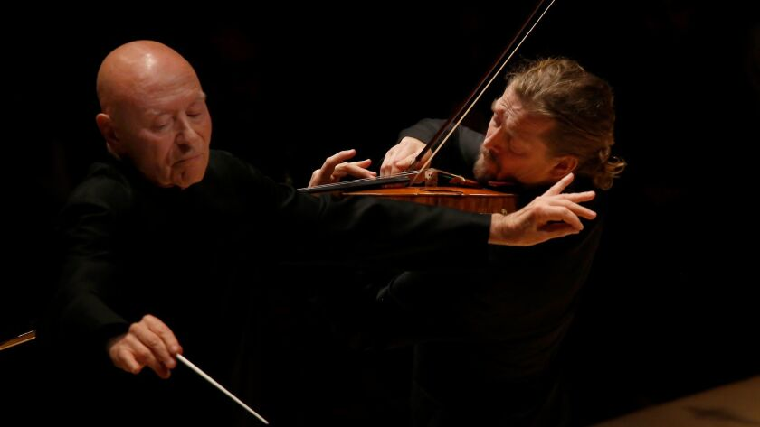 Guest conductor Christoph Eschenbach, left, and violinist Christian Tetzlaff perform Friday night with the Los Angeles Philharmonic at Walt Disney Concert Hall. (Francine Orr / Los Angeles Times)