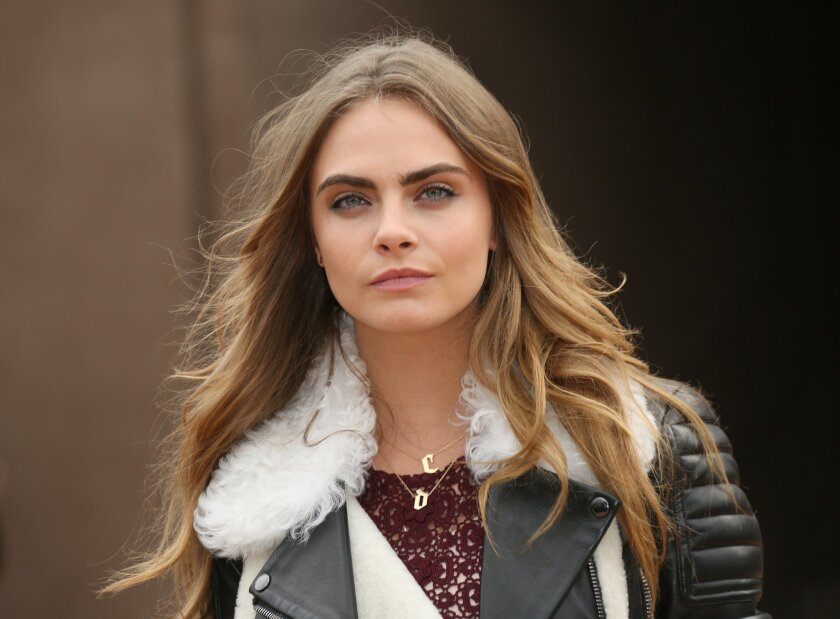 Model Cara Delevingne arrives for the Burberry Womenswear Autumn/Winter 2015 show at London Fashion Week in Kensington Gardens, west London, Monday, Feb. 23, 2015. (Photo by Joel Ryan/Invision/AP)