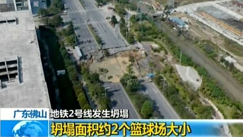 An image taken from China's CCTV shows the section of collapsed road in Foshan.