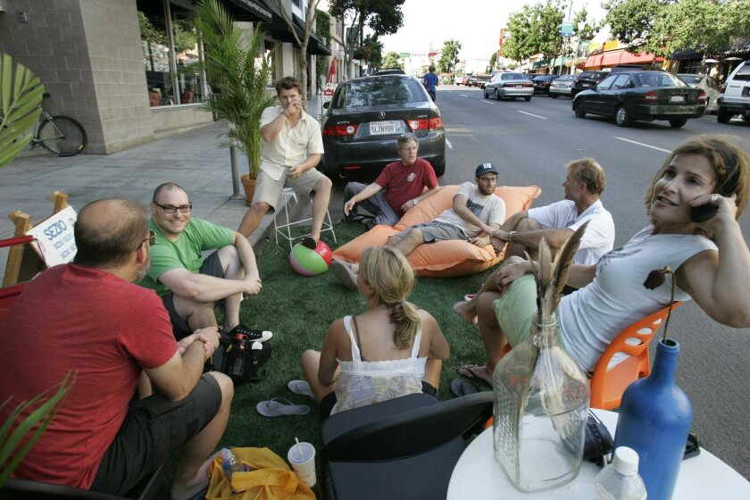 "Leslee Shaffer, far right on the phone, has run the San Diego Architectural Foundation since 2006. This photo is from a ""parklet"" -- a temporary park on a parking space -- event."