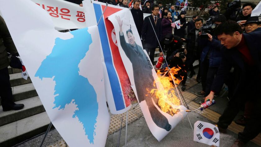 South Koreans burn a portrait of North Korean leader Kim Jong Un in front of the Seoul railway station on Jan. 22, 2018. They were protesting a visit by Hyon Song Wol, head of North Korea's art troupe.