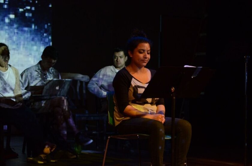 "Chris Cortez , on stage with other students during a rehearsal of ""Un-Sheltered"" at Mesa College, helped create the play by interviewing a homeless woman."