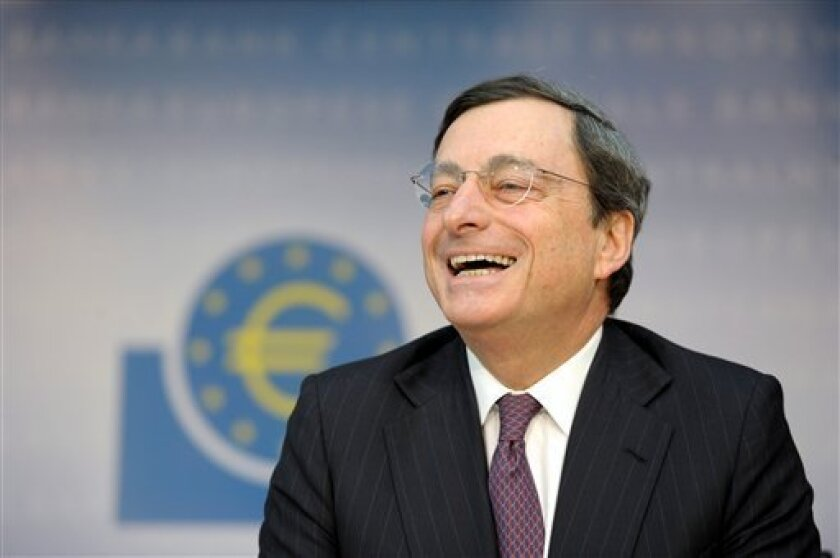 The President of the European Central Bank , Mario Draghi, laughs during a press conference in Frankfurt, central Germany, Thursday Feb. 9, 2012. The European Central Bank left its benchmark interest rate unchanged at a record low 1 percent on Thursday while it waits to see whether the economy needs more help as the 17 countries that use the euro struggle with a debt crisis and likely recession. (AP Photo/dapd/ Thomas Lohnes)