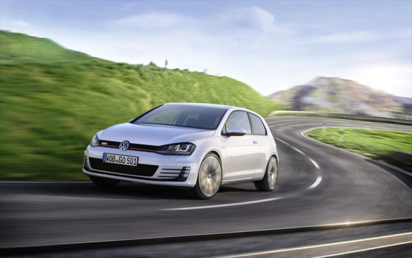 Volkswagen's seventh-generation Golf won the European Car of the Year award ahead of the 2013 Geneva Motor Show. The company also unveiled the 220-horsepower Golf GTI, seen here.